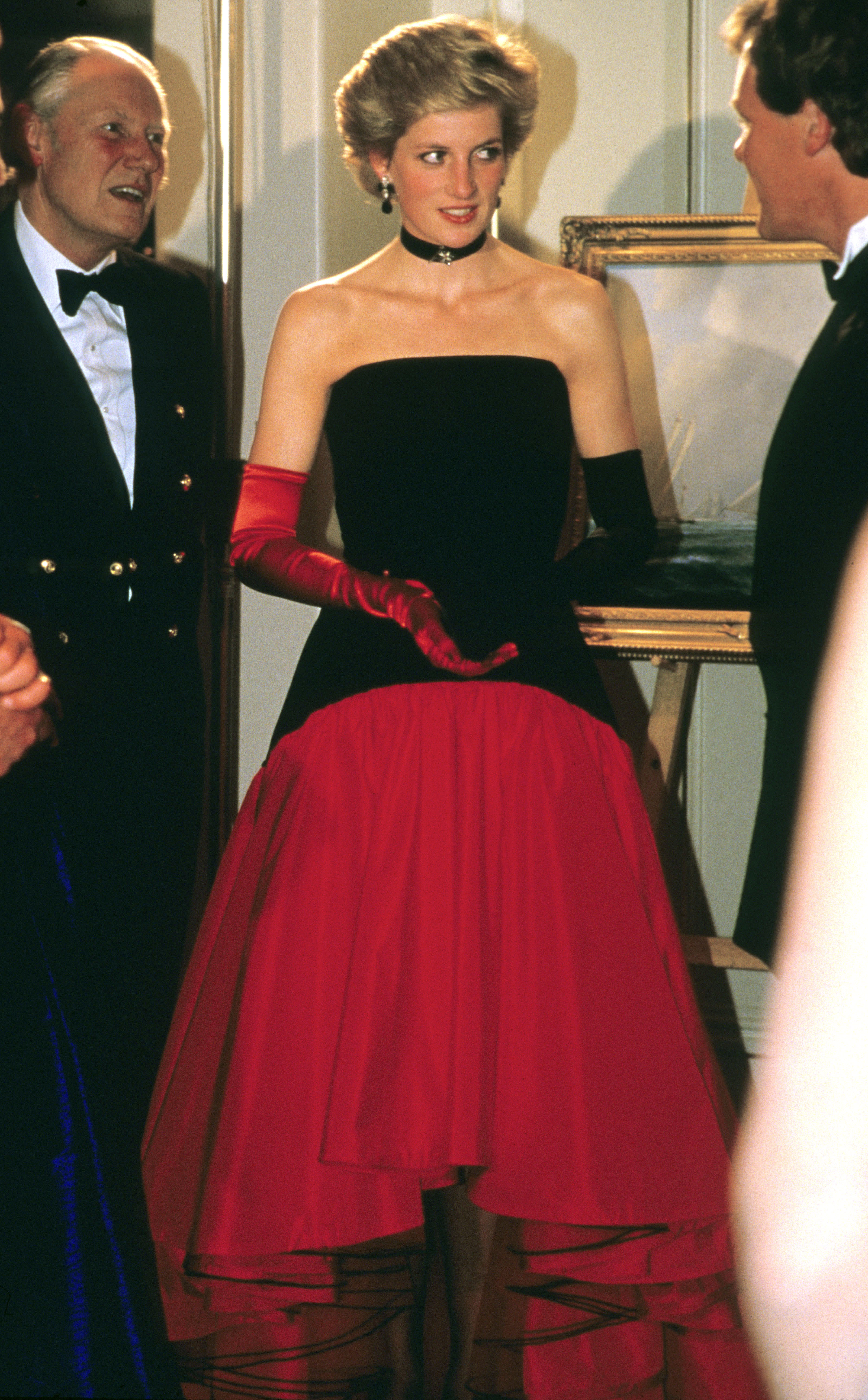 Princess Diana wore one red glove and one back glove while attending the America's Cup Ball at the Grosvenor House hotel in London, in 1986. The gloves complemented her Murray Arbeid flamenco dress.
