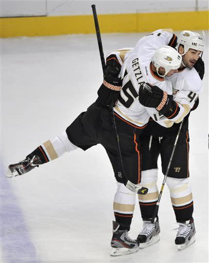 Anaheim Ducks' Sheldon Souray right, celebrates with teammate Ryan Getzlaf, left, after scoring against the Chicago Blackhawks during the third period of an NHL hockey game in Chicago, Friday, March, 29, 2013. Anaheim won 2-1. (AP Photo/Paul Beaty)