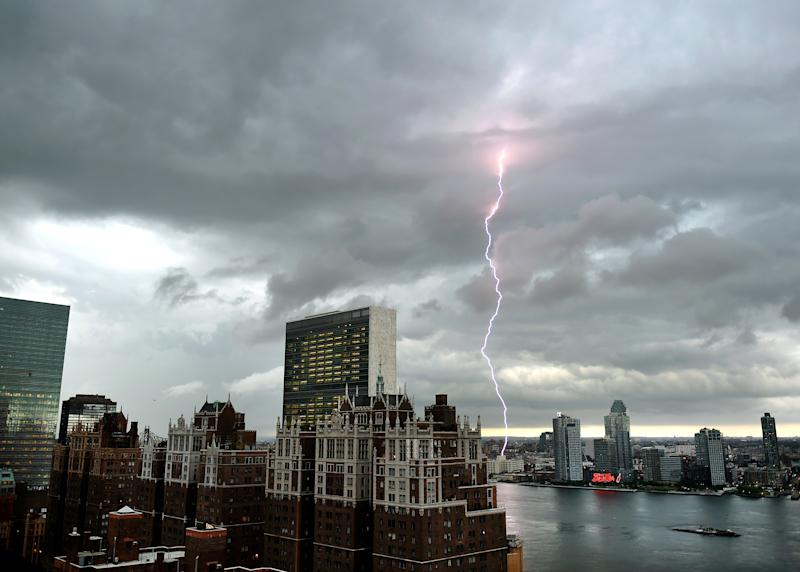 Lightning strikes over the East River as a major storm approaches New York City on July 2, 2014