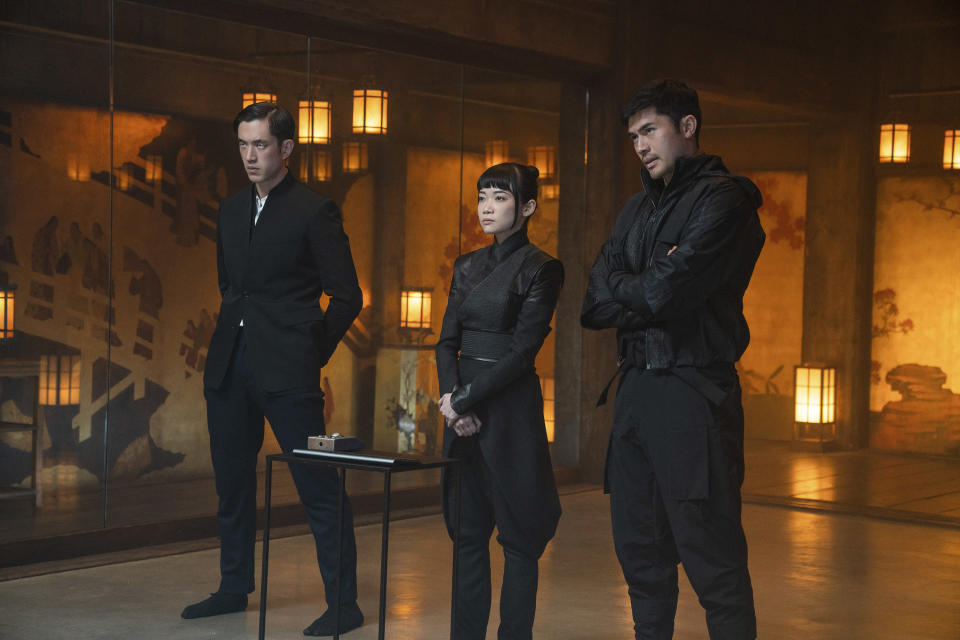 """This image released by Paramount Pictures shows, from left, Andrew Koji, Haruka Abe and Henry Golding in a scene from """"Snake Eyes: G.I. Joe Origins."""" (Scott Garfield/Paramount Pictures via AP)"""
