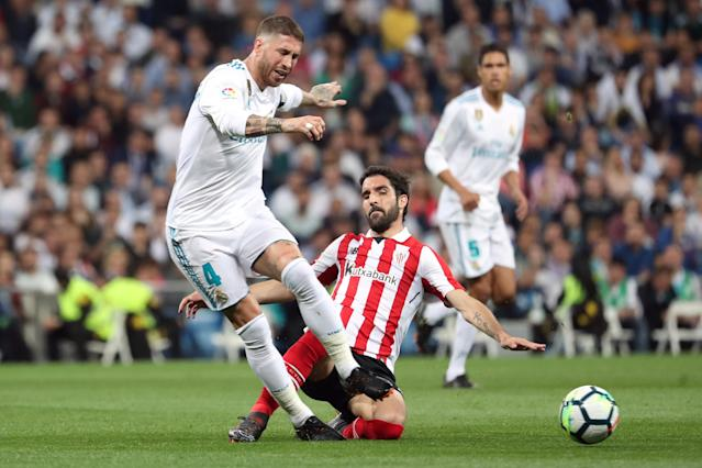 Soccer Football - La Liga Santander - Real Madrid vs Athletic Bilbao - Santiago Bernabeu, Madrid, Spain - April 18, 2018 Real Madrid's Sergio Ramos in action with Athletic Bilbao's Raul Garcia REUTERS/Susana Vera