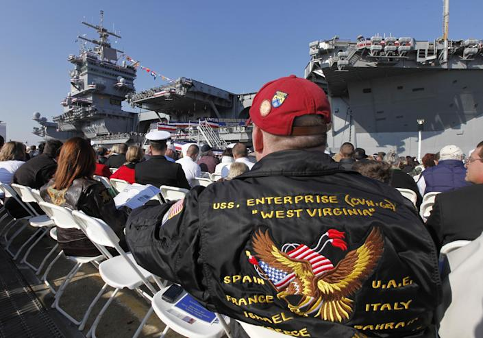 Ronnie Jarrett, of Danville Pa., wears his USS Enterprise cruise jacket during the inactivation ceremony for the first nuclear powered aircraft carrier USS Enterprise at Naval Station Norfolk Saturday, Dec. 1, 2012 in Norfolk, VA. The ship served in the fleet for 51 years. (AP Photo/Steve Helber)