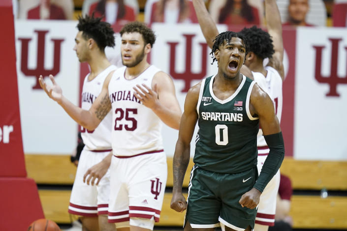 Michigan State's Aaron Henry (0) reacts after hitting a shot and getting fouled during the second half of an NCAA college basketball game against Indiana, Saturday, Feb. 20, 2021, in Bloomington, Ind. Michigan State won 78-71. (AP Photo/Darron Cummings)