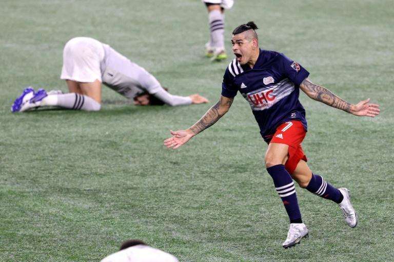 Gustavo Bou celebrates his stoppage time winner in New England's 2-1 MLS play-off victory over Montreal Impact on Friday