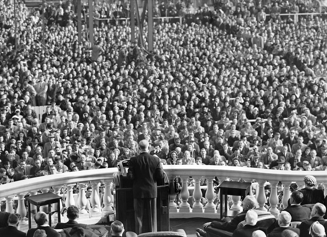 A sea of spectators listen as President Dwight D. Eisenhower delivers inaugural address in Washington, Jan. 20, 1953. (AP Photo)
