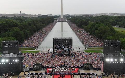 President Donald Trump speaks during an Independence Day celebration in front of the Lincoln Memorial  - Credit: AP