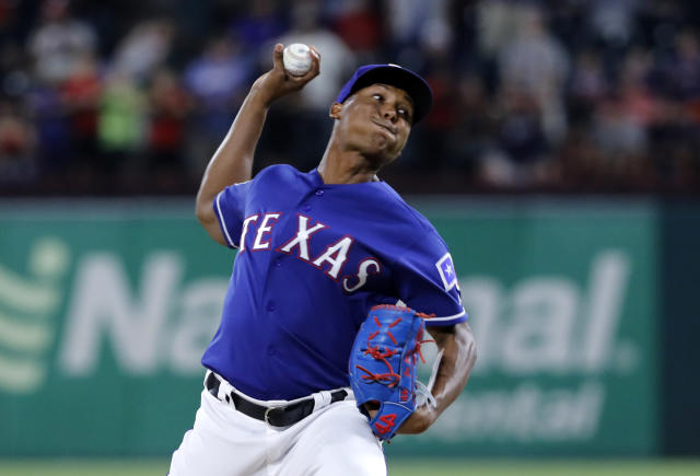 Texas Rangers' Jose Leclerc throws to a Detroit Tigers batter during the ninth inning of a baseball game in Arlington, Texas, Friday, Aug. 2, 2019. (AP Photo/Tony Gutierrez)