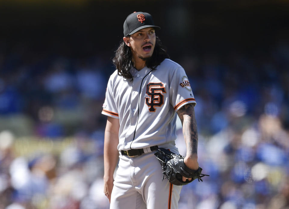 San Francisco Giants starter Dereck Rodriguez reacts during a pitching change during the fifth inning of a baseball game against the Los Angeles Dodgers in Los Angeles, Sunday, Sept. 8, 2019. (AP Photo/Kelvin Kuo)