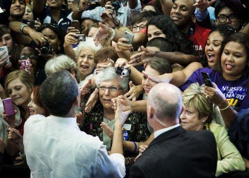 <p>US President Barack Obama greets supporters after speaking about tax reform at Florida Atlantic University in Boca Raton, Florida. Obama's campaign formally welcomed Republican Mitt Romney to the White House duel Tuesday, with a caustic warning: the more Americans see of him, the less they like him.</p>