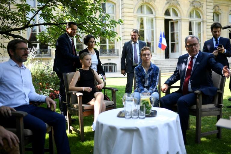 Before her speech, Thunbergwas received by President of the French National Assembly Richard Ferrand (R) in the garden of the Hotel de Lassay