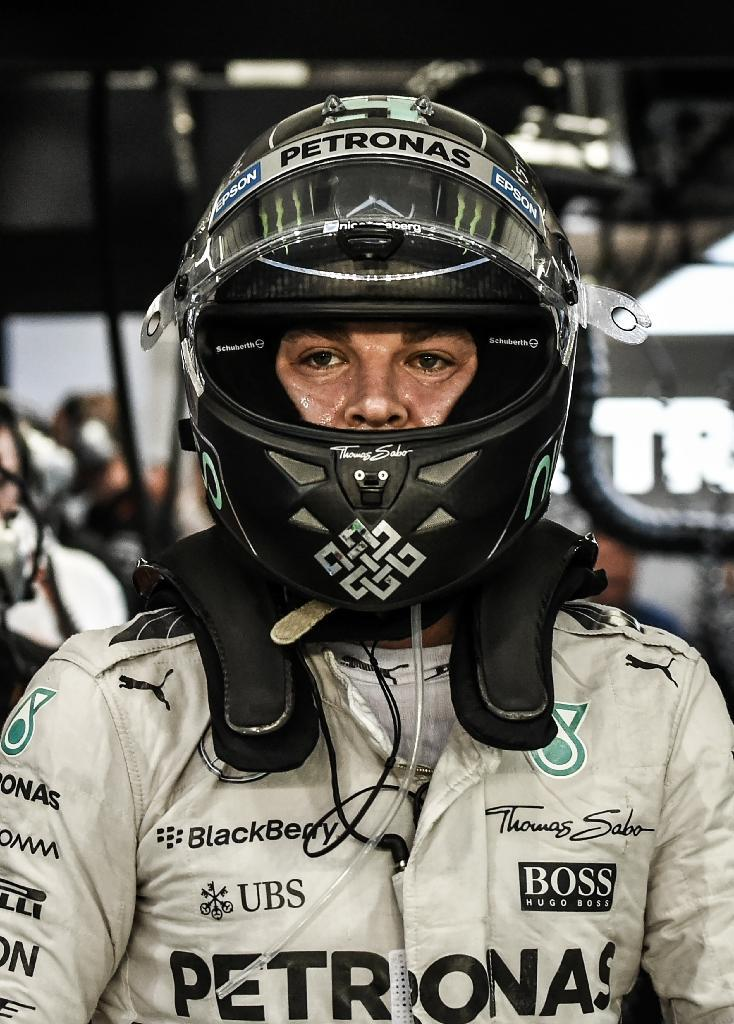 German Formula One driver Nico Rosberg walks in the pit lane after the third free practice session ahead of the Singapore Grand Prix on September 19, 2015 (AFP Photo/Mohd Rasfan)