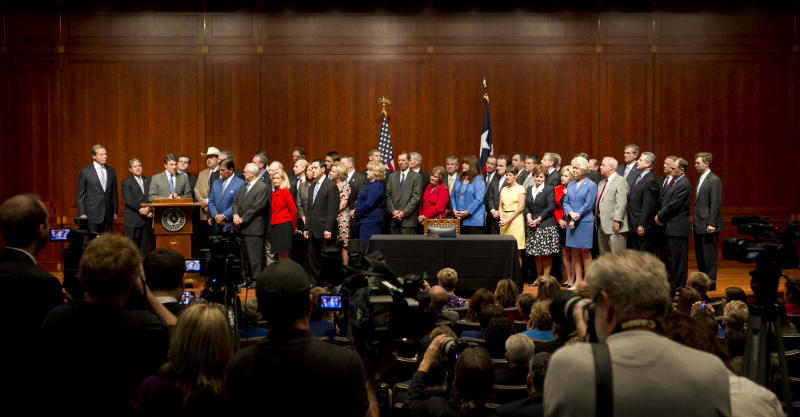 Gov. Rick Perry, third from left, speaks at a signing ceremony for the the abortion restriction bill, House Bill 2, at the Capitol in Austin, Texas, on Thursday July 18, 2013. Perry signed sweeping new abortion restrictions on Thursday that could shutter most of the clinics in the nation's second most populous state. (AP Photo/Austin American-Statesman, Jay Janner) AUSTIN CHRONICLE OUT, COMMUNITY IMPACT OUT, MAGS OUT; NO SALES; INTERNET AND TV MUST CREDIT PHOTOGRAPHER AND STATESMAN.COM (AP Photo/Austin American-Statesman, Jay Janner)
