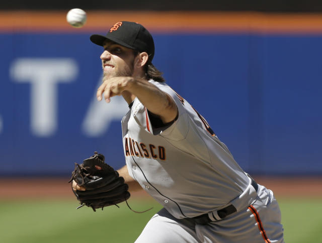 San Francisco Giants' Madison Bumgarner throws a pitch during the first inning of a baseball game against the New York Mets Thursday, Sept. 19, 2013, in New York. (AP Photo/Frank Franklin II)