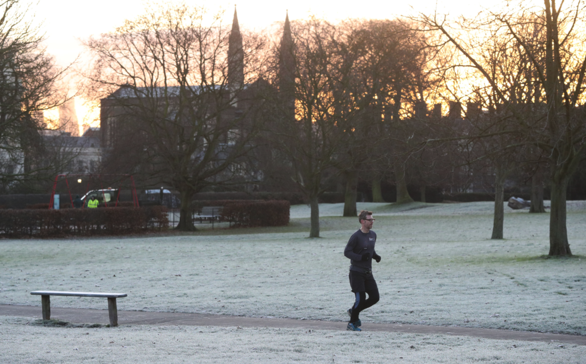 <p>A jogger runs through a frosty Regents Park in London (Picture: PA) </p>