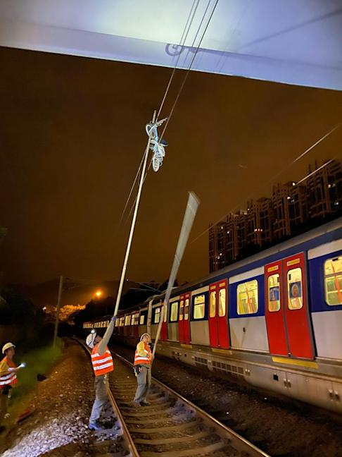 A bicycle was left hanging on an overhead cable on the MTR track in Fanling, leading to service delays. Photo: Handout