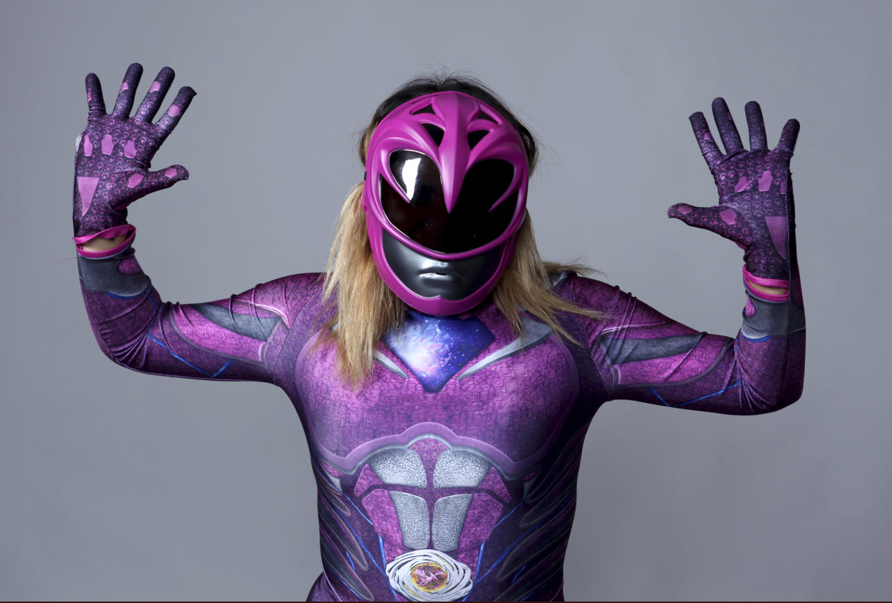 Audrey Chavez, dressed as a Power Ranger, of San Diego, poses for a portrait on day three of Comic-Con International on Saturday, July 21, 2018, in San Diego. (Photo by Rebecca Cabage/Invision/AP)