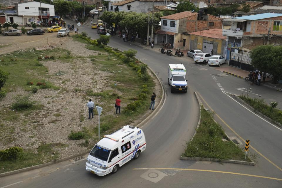 Ambulances drive towards the military base where a car bomb exploded in Cucuta, Colombia, Tuesday, June 15, 2021. Colombian authorities still have not confirmed how many were injured in the explosion. (AP Photo/Ferley Ospina)