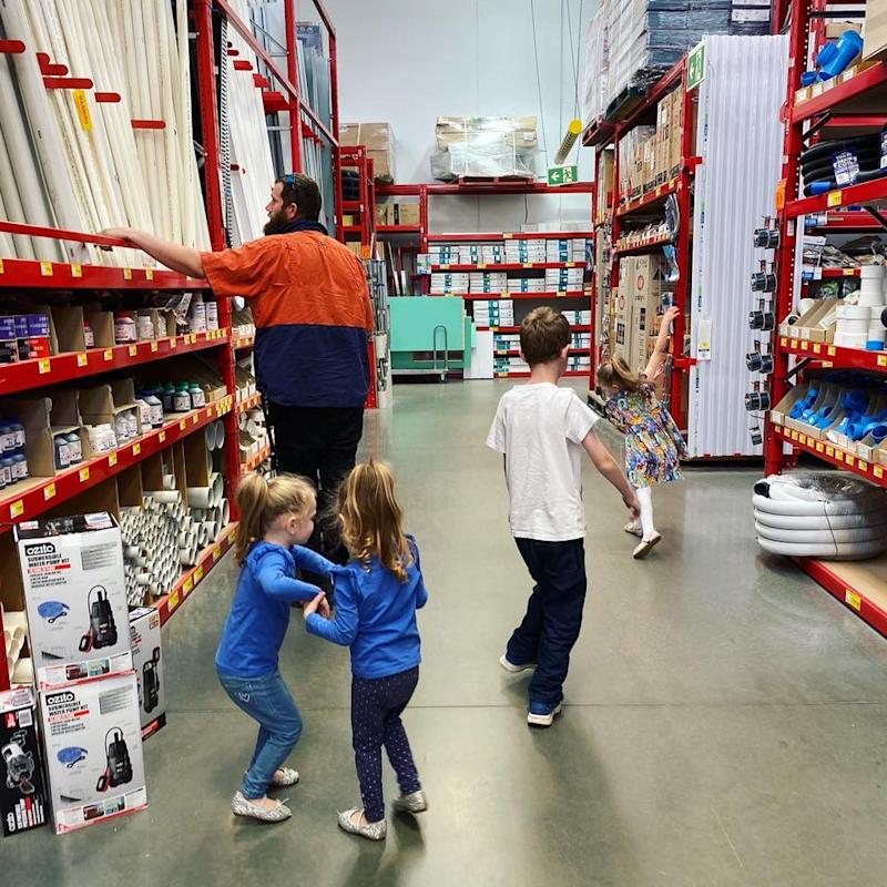 Gary Pascoe and his children shopping at Bunnings