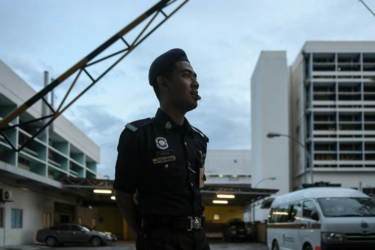 A Malaysian policeman stand guard by the forensics wing of Kuala Lumpur Hospital, where the body of Kim Jong-Nam, half-brother of North Korea's leader Kim Jong-Un, lies on March 29, 2017