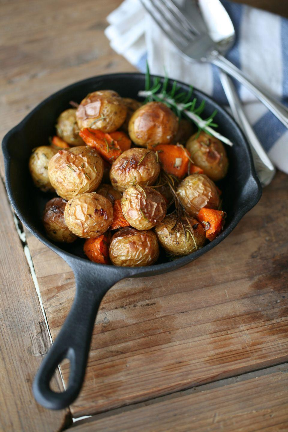 "<p>Upgrade roasted potatoes by using aromatic rosemary. It's delicious, and your kitchen will smell wonderful!</p><p><strong><a href=""https://www.countryliving.com/food-drinks/recipes/a1546/rosemary-roasted-potatoes-3658/"" rel=""nofollow noopener"" target=""_blank"" data-ylk=""slk:Get the recipe"" class=""link rapid-noclick-resp"">Get the recipe</a>.</strong></p><p><a class=""link rapid-noclick-resp"" href=""https://www.amazon.com/dp/B07PP9TPRZ/?tag=syn-yahoo-20&ascsubtag=%5Bartid%7C10050.g.1050%5Bsrc%7Cyahoo-us"" rel=""nofollow noopener"" target=""_blank"" data-ylk=""slk:SHOP CAST IRON SKILLETS"">SHOP CAST IRON SKILLETS</a><br></p>"