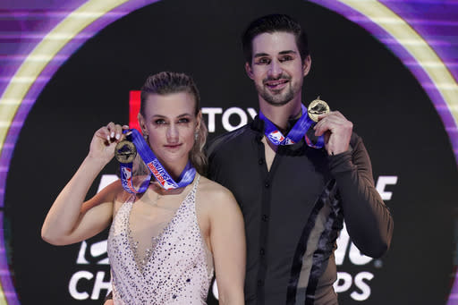 First place finishers Madison Hubbell and Zachary Donohue pose with their medals in the championship ice dance at the U.S. Figure Skating Championships, Saturday, Jan. 16, 2021, in Las Vegas. (AP Photo/John Locher)