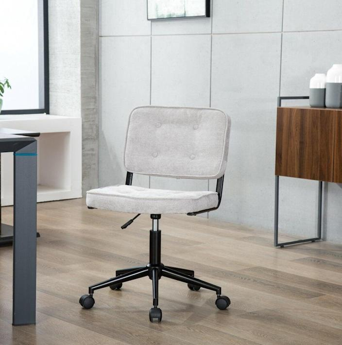 """<h2>Millwood Pines Electra Task Chair</h2><br>Wayfair describes this chair as a """"classy companion for the office,"""" and we agree. Both the white and bronze colorways give off a luxe feel without the luxe price tag and according to reviewers, this design was made for crossed-legs. <br><br><strong>The Hype</strong>: 4.3 out of 5 stars and 309 reviews<br><br><strong>WFH Pros Say</strong>: """"Arrived in time, was easy to assemble. I decided to go with this chair based on the recommendation of another reviewer who sits cross-legged while working (I am the same!) and it works perfectly for that. Lots more control over posture without armrests and all that. Comfortable, adjustable height. If more cushions are needed I can definitely get a pillow for the seat, but I like a more firm chair.""""<br><br><em>Shop</em> <strong><em><a href=""""https://www.wayfair.com/brand/bnd/millwood-pines-b44301.html"""" rel=""""nofollow noopener"""" target=""""_blank"""" data-ylk=""""slk:Millwood Pines"""" class=""""link rapid-noclick-resp"""">Millwood Pines</a></em></strong><br><br><strong>Electra</strong> Electra Task Chair, $, available at <a href=""""https://go.skimresources.com/?id=30283X879131&url=https%3A%2F%2Fwww.wayfair.com%2Ffurniture%2Fpdp%2Fmillwood-pines-electra-task-chair-osbm1090.html"""" rel=""""nofollow noopener"""" target=""""_blank"""" data-ylk=""""slk:Wayfair"""" class=""""link rapid-noclick-resp"""">Wayfair</a>"""