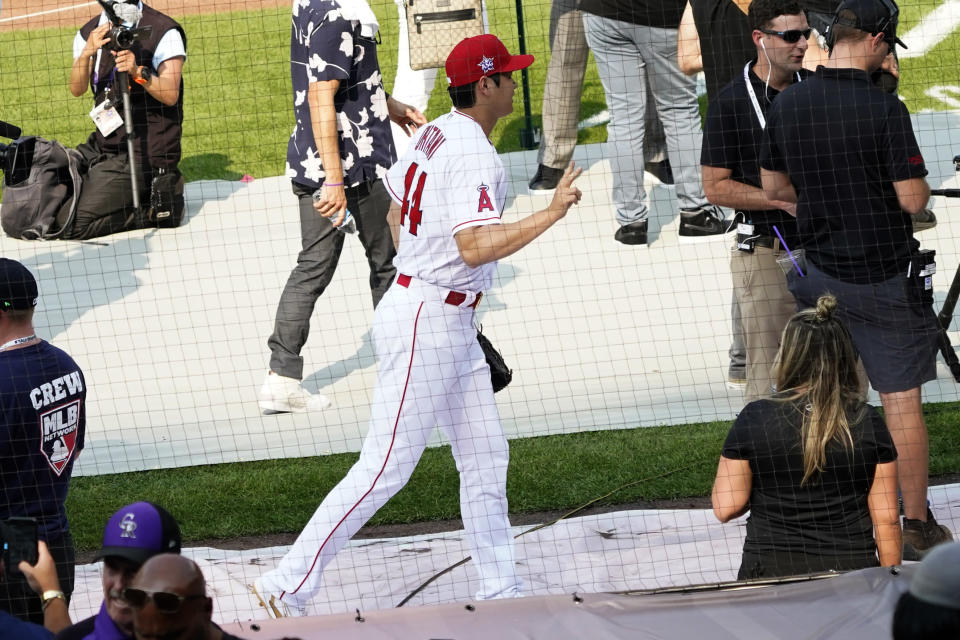 American League's Shohei Ohtani, of the Los Angeles Angeles, leaves the field after batting practice for the MLB All-Star baseball game, Monday, July 12, 2021, in Denver. (AP Photo/Gabriel Christus)