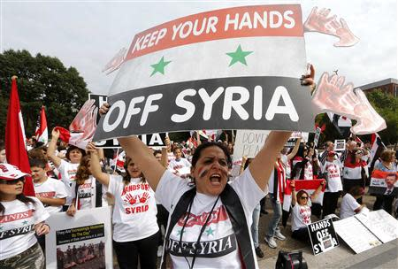 Syrian-American demonstrator Manar Kodamah leads a chant against possible U.S. military intervention in the conflict in Syria as a group of Syrian-Americans protest in front of the White House in Washington, September 9, 2013. REUTERS/Jim Bourg