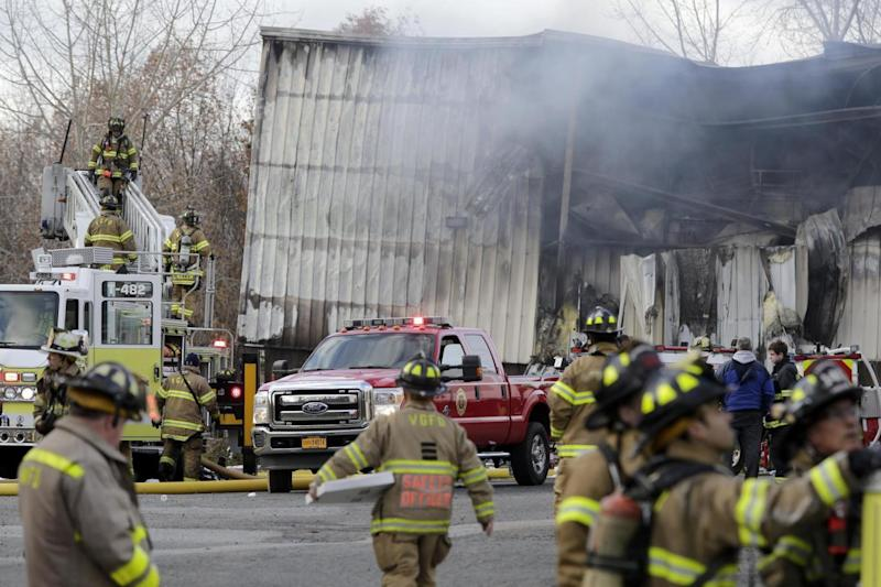 Firefighters at the scene of the factory fire in New Windsor (AP)