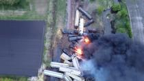 Fire is seen on a Union Pacific train carrying hazardous material that has derailed in Sibley, Iowa, U.S., in this still frame obtained from social media drone video dated May 16, 2021