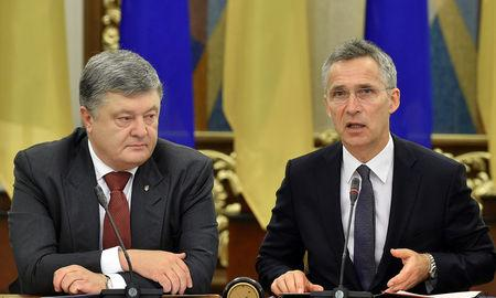Ukrainian President Petro Poroshenko and NATO Secretary General Jens Stoltenberg attend a meeting in Kiev