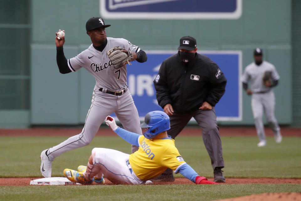 Boston Red Sox's Enrique Hernandez, bottom, is out at second as Chicago White Sox shortstop Tim Anderson (7) throws to first to complete the double play during the first inning of a baseball game, Saturday, April 17, 2021, in Boston. (AP Photo/Mary Schwalm)