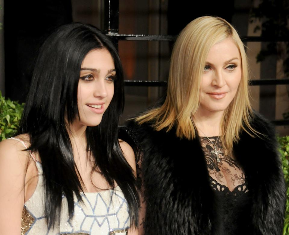 WEST HOLLYWOOD, CA - FEBRUARY 27: Actress/singer Madonna and daughter Lourdes Leon arrive at the Vanity Fair Oscar Party 2011, February 27, 2011 at the Sunset Tower Hotel in West Hollywood, California.  (Photo by Gregg DeGuire/FilmMagic)