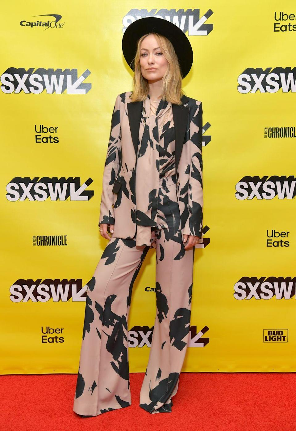 <p> Wilde opted for a wide-rim black hat and a three-piece Elie Saab floral-print suit for the panel event. </p>