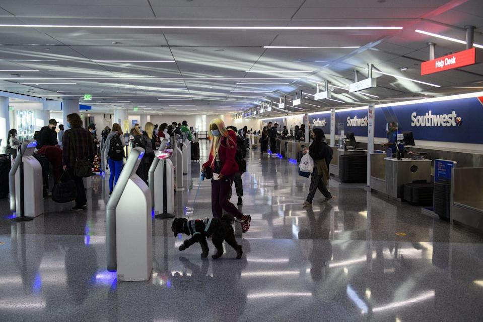 Passengers check-in for a Southwest Airlines flight