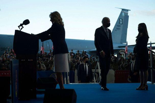 PHOTO: First Lady Jill Biden speaks as President Joe Biden arrives on the podium prior to addressing U.S. Air Force personnel and their families stationed at Royal Air Force Mildenhall, Suffolk, England, on June 9, 2021. (Brendan Smialowski/AFP via Getty Images)
