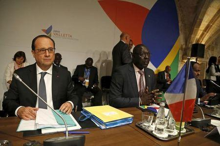French President Francois Hollande (L) and Gambia's trade minister Abdoulie Jobe attend the Valletta Summit on Migration in Valletta, Malta, November 12, 2015. REUTERS/Darrin Zammit Lupi