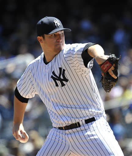New York Yankees starting pitcher Phil Hughes throws against the Oakland Athletics in the first inning of a baseball game at Yankee Stadium on Saturday, May 4, 2013 in New York. (AP Photo/Kathy Kmonicek)