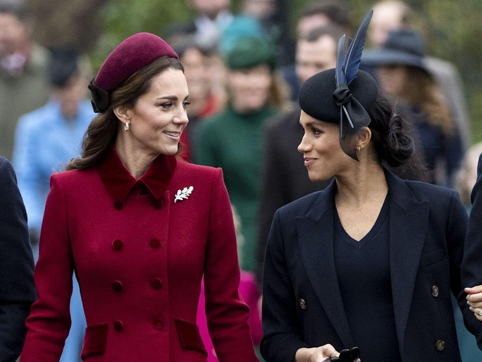 """<p>Meghan and Kate share a smile on the walk in to St. Mary Magdalene church. <a href=""""https://www.townandcountrymag.com/society/tradition/g25577594/royal-family-christmas-church-photos-2018/"""" rel=""""nofollow noopener"""" target=""""_blank"""" data-ylk=""""slk:See more photos from this year's celebration here."""" class=""""link rapid-noclick-resp"""">See more photos from this year's celebration here.</a></p>"""