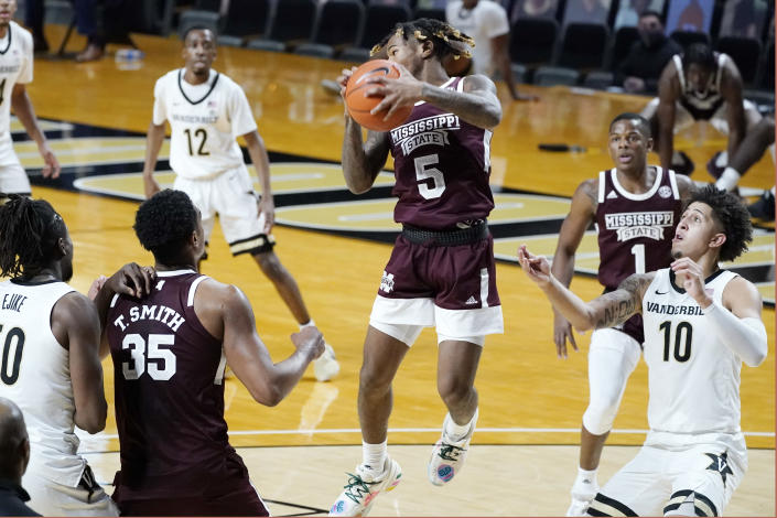 Mississippi State guard Deivon Smith (5) grabs a rebound in the first half of an NCAA college basketball game against Vanderbilt Saturday, Jan. 9, 2021, in Nashville, Tenn. (AP Photo/Mark Humphrey)