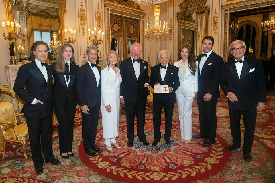 Prince Charles presents Ralph Lauren (fourth right with his family), with his honorary Knight Commander of the Order of the British Empire for services to fashion, in a private ceremony at Buckingham Palace, June 19, 2019.