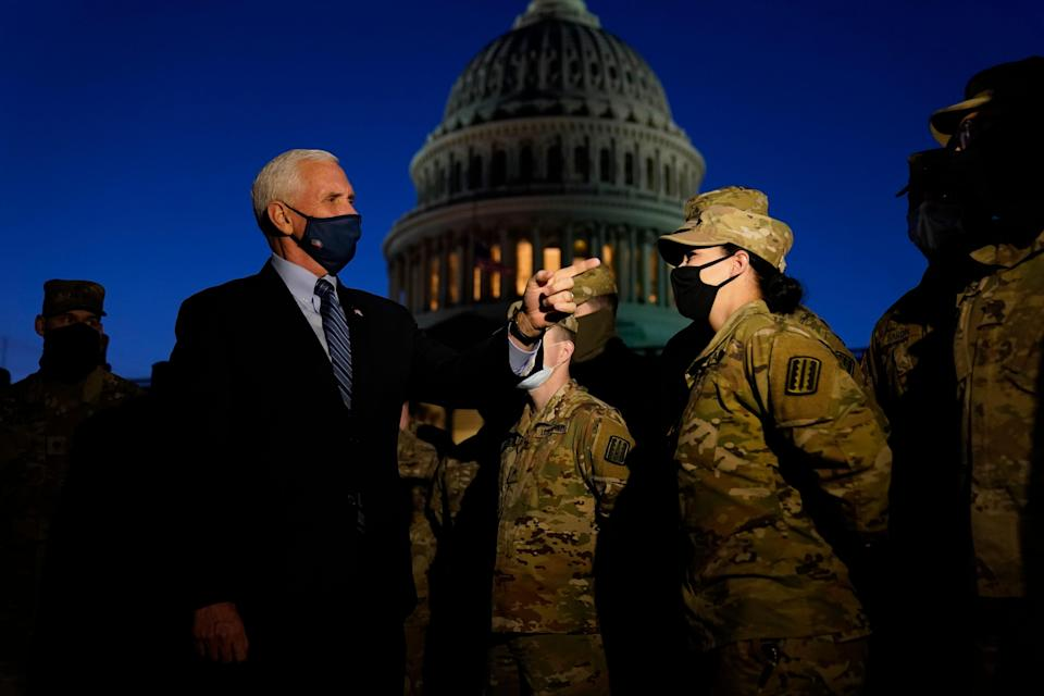 Vice President Mike Pence speaks to National Guard troops outside the U.S. Capitol, Thursday, Jan. 14, 2021, in Washington.