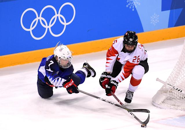 <p>Monique Lamoureux-Morando #7 of the United States fights for the puck with Emily Clark #26 of Canada in the third period during the Women's Gold Medal Game on day thirteen of the PyeongChang 2018 Winter Olympic Games at Gangneung Hockey Centre on February 22, 2018 in Gangneung, South Korea. (Photo by Harry How/Getty Images) </p>