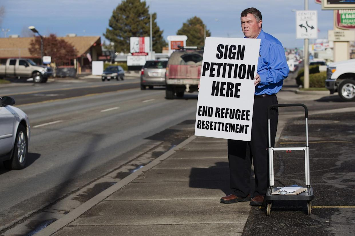 Rick Martin, head of the Committee to End the College of Southern Idaho's Refugee Center, gathers petition signatures in Twin Falls in 2015. (Photo: Otto Kitsinger/AP)