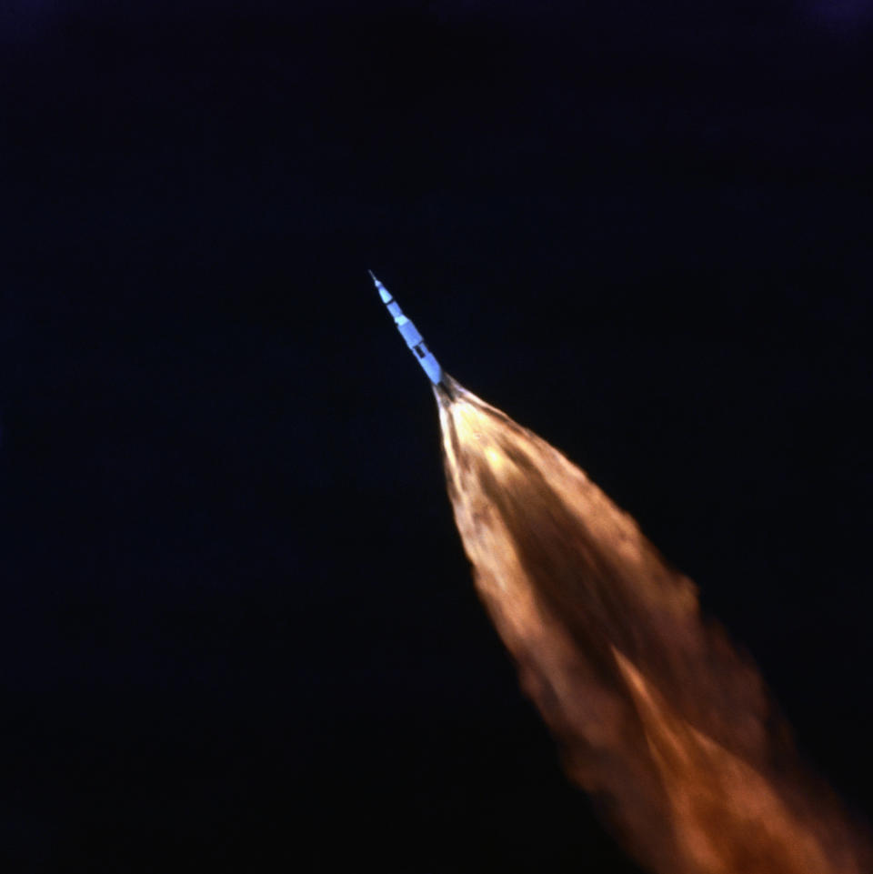 Tracking camera follows Saturn V shortly after July 16th moon launch here. Flames jet from booster rocket, as Apollo 11 craft streaks across the sky. (Photo: NASA/Bettmann Archive/Getty Images)