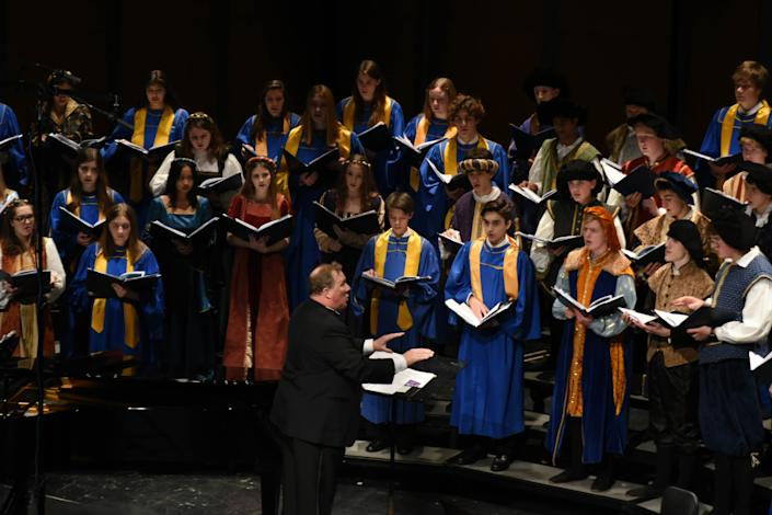 Tim Haskett conducts the Lake Forest High School choir at a 2019 holiday concert. (Courtesy Visual Image Photography)