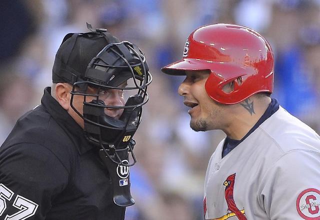 St. Louis Cardinals' Yadier Molina talks to umpire Mike Everitt after striking out during the first inning of Game 3 of the National League baseball championship series against the Los Angeles Dodgers, Monday, Oct. 14, 2013, in Los Angeles. (AP Photo/Mark J. Terrill)