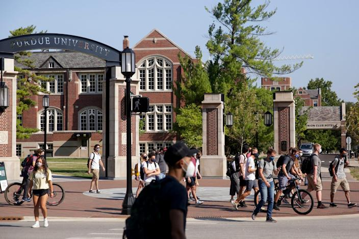 Students cross the State and Grant streets intersection at Purdue University, Monday, Aug. 24, 2020 in West Lafayette.