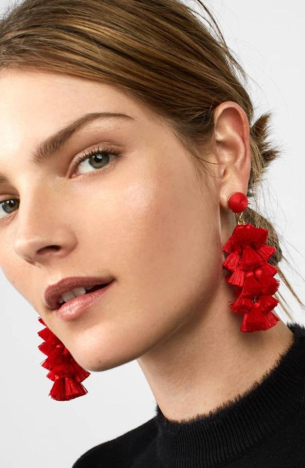 """<p>Help them dress up their date-night look with these <a href=""""https://www.popsugar.com/buy/BaubleBar-Contessa-Tassel-Earrings-405880?p_name=BaubleBar%20Contessa%20Tassel%20Earrings&retailer=shop.nordstrom.com&pid=405880&price=38&evar1=fab%3Aus&evar9=45687723&evar98=https%3A%2F%2Fwww.popsugar.com%2Ffashion%2Fphoto-gallery%2F45687723%2Fimage%2F45687731%2FBaubleBar-Contessa-Tassel-Earrings&list1=shopping%2Cgifts%2Cgift%20guide%2Cvalentines%20day%2Cvalentines%20day%20gift%20guide%2Cgifts%20for%20women&prop13=mobile&pdata=1"""" rel=""""nofollow"""" data-shoppable-link=""""1"""" target=""""_blank"""" class=""""ga-track"""" data-ga-category=""""Related"""" data-ga-label=""""https://shop.nordstrom.com/s/baublebar-contessa-tassel-earrings/4866635?origin=category-personalizedsort&amp;breadcrumb=Home%2FHome%20%26%20Gifts%2FGifts%2FGifts%20for%20Her&amp;color=red"""" data-ga-action=""""In-Line Links"""">BaubleBar Contessa Tassel Earrings </a> ($38).</p>"""