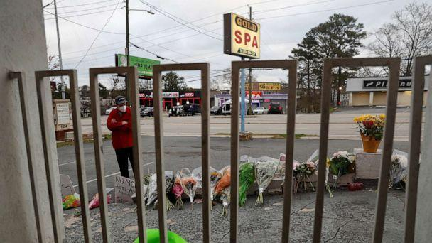 PHOTO: Sasha Hasanbegovic looks down after laying flowers at a makeshift memorial outside the Gold Spa following the deadly shootings in Atlanta, March 19, 2021. (Shannon Stapleton/Reuters)